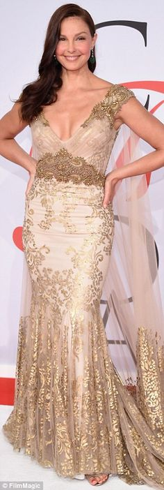Always a bombshell: Actress Ashley Judd looked like a Southern belle in this gold and beig...