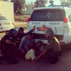 A picture you will never see outside of Israel. Israeli soldiers help Palestinian children escape the rockets from Gaza!