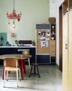 Cork board on 'fridge in kitchen by Jean Prouve.