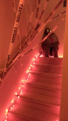huge roll of caution tape from lowes tied from railing to banister poles halloween