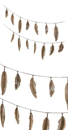 Who knew you could achieve such exceptional lightness and detail when working in iron? The Plume Feather Garland demonstrated that clearly, delivering decorative appeal and artistry to your space. Hang...  Find the Plume Feather Garland, as seen in the Handwoven Bohemian Home Collection at http://dotandbo.com/collections/handwoven-bohemian-home?utm_source=pinterest&utm_medium=organic&db_sku=126800