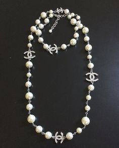 CHANEL CHANEL Silver Toned 5 Crystal CC Pearl Strand Necklace Double-sided crystal encrusted CC hardware chain-link in between pearl strand Chan Chanel Pearl Necklace, Pearl Necklace Designs, Chanel Pearls, Chanel Jewelry, Pearl Jewelry, Jewelery, Fashion Jewelry, Pearl Necklace Outfit, Lego Necklace