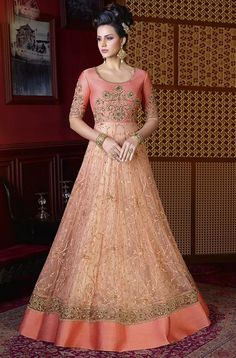Designer Peach Color Premium Net Embroidered Wedding Wear Anarkali Suit Perfect for special occasions, this stylish peach color beautiful embroidered wedding wear salwar kameez. Its embroidered work over the attire will add luxurious charm to its gl Designer Anarkali, Bollywood Designer Sarees, Designer Gowns, Designer Wear, Robe Anarkali, Costumes Anarkali, Anarkali Suits, Lehenga Choli, Bridal Lehenga
