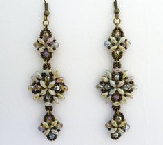 Free Twins and SuperDuos Bead Patterns including Easy SuperDuo Earrings, Antique SuperDuo Pendant and Simplicity SuperDuo Bracelet, along with videos on Super duo (Daffodil) Flower Pendant Beading Tutorial, Fun Floral Necklace and How to Make SuperDuo Beaded Beads.