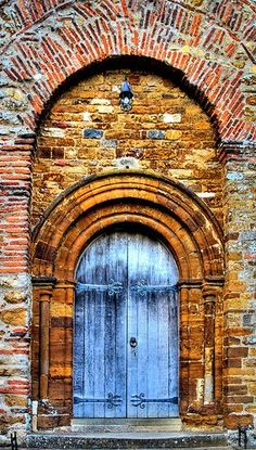 The door of a Saxon church in Northamptonshire, England via Flickr by jdnpics.
