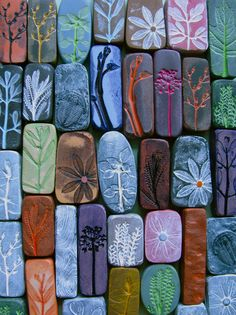 Ideas for making back splash tiles. These are polymer clay floral imprint pendants. i love the ones with contrasting colors.