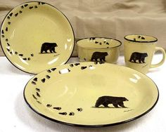 This 16-piece dinnerware set features bear tracks that circle & Rustic Retreat Dinnerware Set - 16 pieces | Dinnerware Cabin and ...