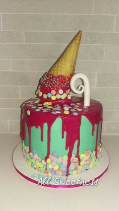 Chocolate drip cake with a waffle cone, made by All Sweetness