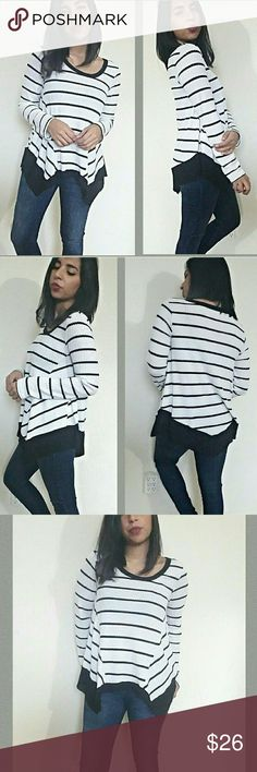 |new | WHITE BLACK ASYMMETRICAL STRIPE TOP Comfy and chic striped longsleeve top. Features a waffle/thermal feel with asymmetrical sides. Hemline has a thick black contrast line. Soft texture. Love it! Fits TTS.   Modeling size Medium  Sizes available  S M   Tops