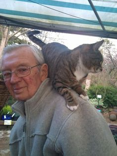 """This is my dad in the last few months of his life. He was given 3-5 months and he fought it bravely for 8 months. This was a good day after a chemo session.  You can't see it but he had a tracheotomy and he could no longer speak.  This cat jumped on his back at a garden centre and wouldn't get down. He must have known how precious he was lol. Love you dad 2 yrs on and it feels as raw as ever x"" - Amanda Turner Was Garnham"