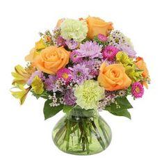 Long lasting varieties of beautiful premium blooms in a pastel vase.