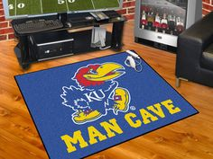 "The Kansas Jayhawks Man Cave All-Star Area Rug by FanMats measures 34""x45"""