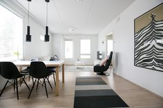 Woodnotes Avenue paper yarn carpet. Scandinavian style. Finnish design. Interior. Dining room.