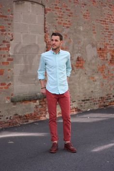Shop this look on Lookastic:  https://lookastic.com/men/looks/light-blue-dress-shirt-red-chinos-burgundy-leather-derby-shoes/12838  — Light Blue Dress Shirt  — Red Chinos  — Burgundy Leather Derby Shoes