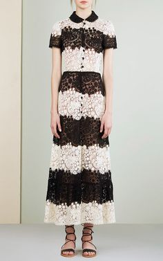 This **Red Valentino** dress features a rounded collar, short sleeves, and contrasting lace panels throughout.
