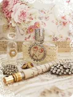 Altered Bottles -Brooches,Perfume,& Roses in the Backround!