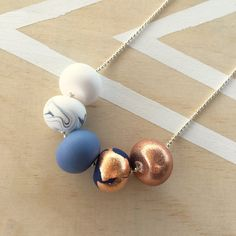 Polymer clay bead necklace. Copper / gold / silver by RafHop