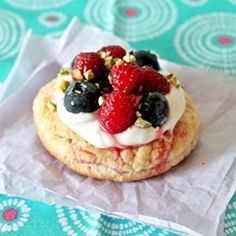 cute berry Tartlettes topped with lavender and rosewater mascarpone cream