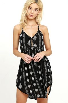 The shining sun and clear skies are calling you and the Amuse Society Ashby Black Print Dress! Gauzy, black viscose with a cream print covers a cutout, triangle bodice with grosgrain ribbon straps embellished in studs and grommets. More adjustable straps grace the low back atop the flaring skirt with rounded hem.