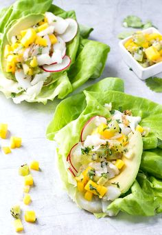 These Fish Taco Lettuce Wraps (made with cod) are so fresh & healthy! Topped with mango salsa & avocado they're an easy 20 minute meal. AIP, Paleo recipe.