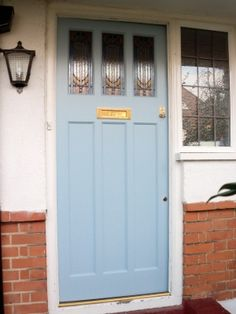 detailed front door in a pale blue - within reach of the pocket of a less ambitious builder/ designer. You can pick these up in salvage/ on ebay at times....people replace them for UPVC - anything for a warmer home!