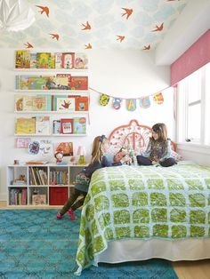 Grace, 8, a voracious reader, props her current favorites on five floating shelves, transforming the book covers into a changeable, colorful art display. Mekea spray-painted the curlicue wicker headboard a pretty coral and paired it with a Serena & Lily elephant-patterned bedspread. An overdyed wool rug from One Kings Lane works with the room.
