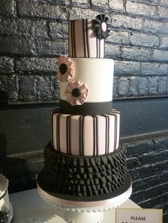 Pale pink, white and black ruffle couture wedding cake with stripes. i love the ruffles