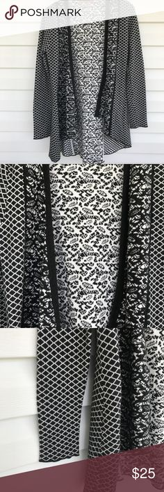 "Belldini Multi Print Cardigan Black and white multi print long cardigan made by Belldini Size Medium 60% Cotton 20% Vicose 20% Nylon Pit to Pit 21"" Length of Sleeve 24"" Length 31"" *All measurements taken flat* Gently Worn Belldini Sweaters Cardigans"
