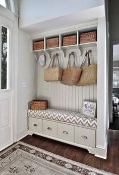 Have tongue and groove paneling and storage bench to save on cost of custom cabinets? Mudroom off entryway with pale greige built-in storage bench with tongue and groove paneled backsplash topped with open storage cubbies. Home Design, Interior Design Kitchen, Porch Interior Ideas, Design Blogs, Interior Livingroom, Design Design, Beach Design, Porch Ideas, Kitchen Designs