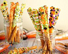 Gourmet Halloween Pretzel Rods by Tiffany We do these every year for just about every holiday. They are super easy and the kids will have a blast helping decorate these babies.Our family likes to make a bunch of these up, wrap them in treat bags with ties, and hand deliver them to all the kiddies …