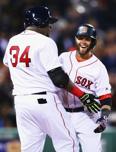 Dustin Pedroia Photos - David Ortiz #34 of the Boston Red Sox congratulates Dustin Pedroia #15 after he hit a grand slam during the second inning against the Atlanta Braves on April 27, 2016 in Boston, Massachusetts. - Atlanta Braves v Boston Red Sox