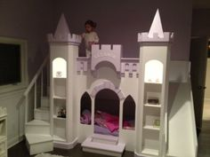 This Princess Castle Loft Playhouse bed will surely make your little one feel like royalty! This particular bed has been built with stairs and a slide. The staircase includes a side storage door and shelving inside. Playhouse Loft Bed, Castle Playhouse, Kids Indoor Playhouse, Loft Bunk Beds, Build A Playhouse, Playhouse Slide, Backyard Playhouse, Princess Bunk Beds, Princess Castle Bed