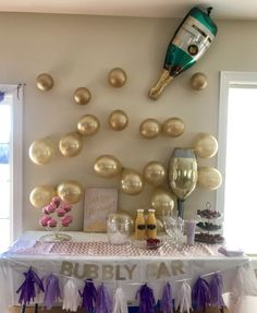 Bubbly Bar - Cascading gold balloons out of a champagne bottle balloon