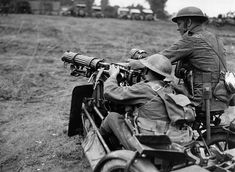 World War I in Photos: In France, a British machine-gun team. The gun, which appears to be a Vickers, is mounted on the front of a motorcycle side car. (National Library of Scotland)