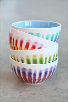 ceramic bowls - re- create with wht found + ripped paper and a washed puddles? Try on mug or vase for full movement .