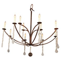 lovely rock crystal chandelier   From a unique collection of antique and modern chandeliers and pendants  at http://www.1stdibs.com/furniture/lighting/chandeliers-pendant-lights/