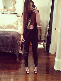 From her graphic tee to her skinny leather pants and T-strap heels, Kylie's selfie look is fierce and edgy! Leather skinnies (there are tons of super affordable faux ones that look just as cool!) are a must for getting Kylie's cool style, but everything else she's wearing can also be easily mixed and matched with other items in your closet.   - Seventeen.com