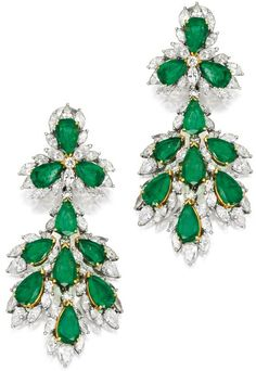 Pair of Platinum, Emerald and Diamond Pendant-Earrings.   Of chandelier design, set with 20 pear-shaped emeralds weighing approximately 23.50 carats, accented by numerous pear and marquise-shaped diamonds weighing approximately 14.50 carats, pendants detachable. Sotheby's.