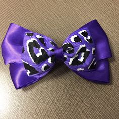 A personal favorite from my Etsy shop https://www.etsy.com/listing/228392579/purple-leopard-print-hair-bow
