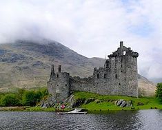 Kilchurn Castle is a ruined 15th and 17th century structure on a rocky peninsula at the northeastern end of Loch Awe, in Argyll and Bute, Scotland.