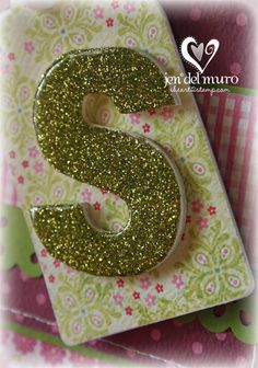 "This technique is really quite simple, but I thought that I would show the step outs on how it is done. It's so much easier to show things in pictures instead of trying to ""show"" them just in words. I wish I had the time to make more tutorials. Maybe this is a start!   Supplies needed: chipboard or thick cardstock die cut, Diamond Glaze/Crystal Effects, fine glitter, adhesive to apply glitter {the MS glitter glue that came with the glitter is shown}.  Apply adhesive to your chipboard.NOTE/TIP: I"