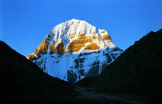 """Mount Kailash is a sacred mountain in western Tibet.  It is also known as Kangri Rinpoche which means """"Precious Snow Mountain""""."""