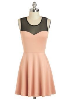 This dress has a sweetheart neckline, but also has mesh solder straps to give more covering.