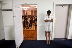 First Lady Michelle Obama waits to be introduced...