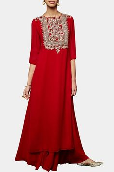 Anita Dongre's red kurta and sharara set promises a luxe look with its cascading silhouette and touch of glamour added by the embroidery on the yoke. Pair it with gold and pearl earrings and wear your hair in a sleek updo. Designer Dress For Men, Indian Designer Wear, Designer Dresses, Pakistani Dresses, Indian Dresses, Indian Outfits, Indian Attire, Indian Wear, Red Kurta