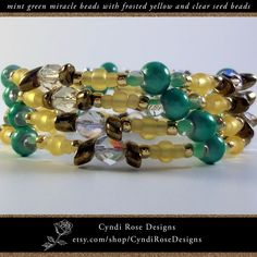 Items similar to Wrap around beaded bracelet with mint green miracle beads, frosted yellow seed beads, clear glass crystals, and bronze magatama beads on Etsy Beaded Jewelry, Beaded Bracelets, Unique Jewelry, Mint Green, Yellow, Faceted Glass, Rose Design, Seed Beads, Spiral