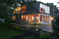 traditional exterior by Frank Shirley Architects - stone facing on flagstone patio - lit stairs