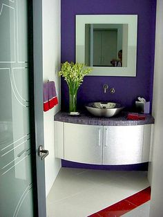 Custom vanity, glass top and vessel sink. Designed by Denise Homme.