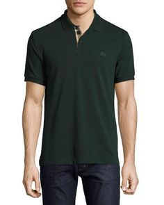 """Burberry Brit oxford polo shirt. Approx. 31""""L down center back. Spread collar; two-button placket with contrast check facing. Mother-of-pearl buttons. Short sleeves with banded cuffs. Tonal equestrian"""