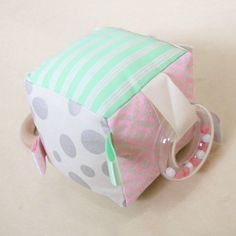 Interactive baby soft block, handmade in Byron Bay by Babee and Me. Pink, mint and silver .